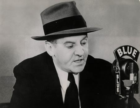 Radio commentator and newspaperman Walter Winchell, in the 'March of Time.'