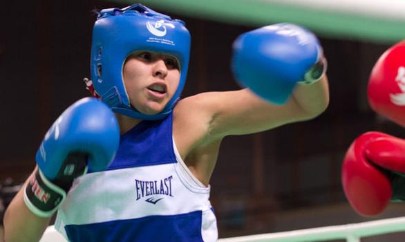 Marlen Esparza, Team USA's flyweight,  losing to Ren Cancan of China. Esparza will still go to the Olympics this summer.