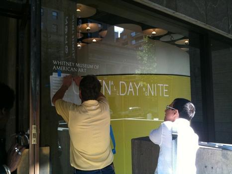 Open All Day and All Night: A sign being installed on the Whitney's window announced the new hours.