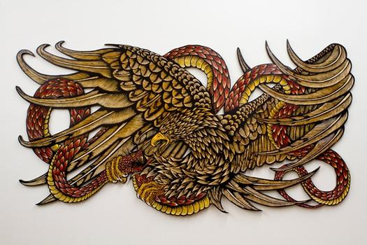'Reaping Sun,' a hand-colored wood carving, also by McNett — an artist known for his intricate prints (some of which have ended up as street art in the past).