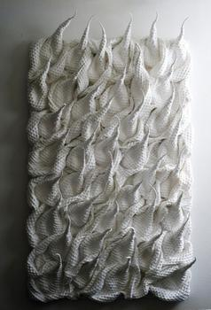 "Hitomi Nagai turns an ordinary waffle weave fabric into a piercing installation titled ""Birth."""