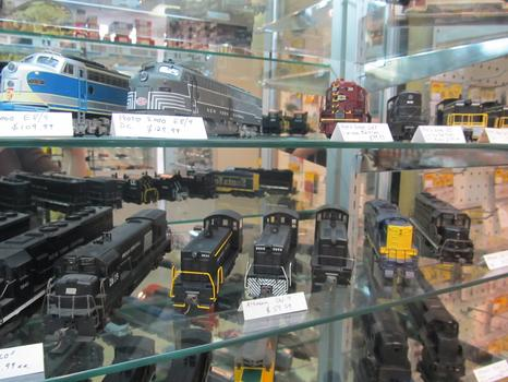 A glass case of train cars shows how widely prices vary, depending on the model, the make and the year.