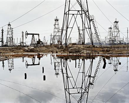 """""""SOCAR Oil Fields #3"""" on view now at the Howard Greenberg Gallery was taken in Baku, Azerbaijan in 2006."""