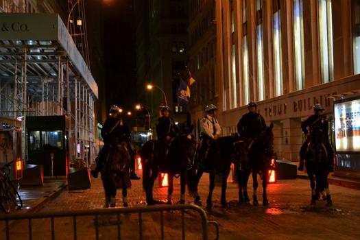 Mounted Police blocked off an empty Wall Street before 3 a.m.