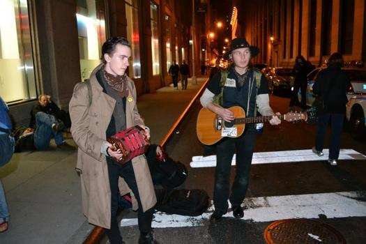Protesters pass the time at Broadway and Pine streets with a little music