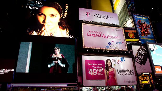 Audiences watch the opening night of the Met Opera in Times Square.