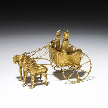 A model of a chariot, found as part of a treasure hoard in what is now Tadjikistan.