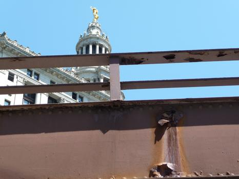 Peeling paint on a ramp -- and the Municipal Building