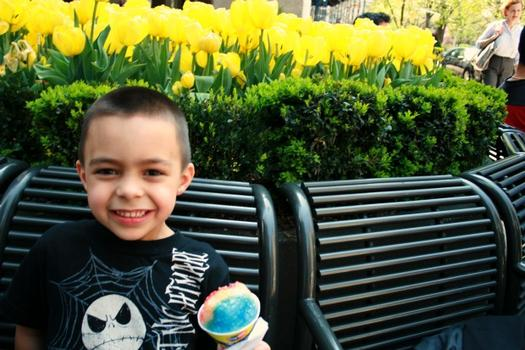 Five-year-old Pedro Correa took a break from daycare with a sno-cone at Mister Softee at 26th Street.