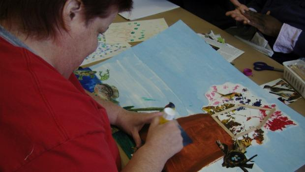 A participant of the Queeens Museum of Art's open studios program works on a mixed-media project.