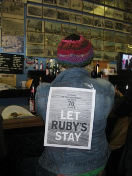 A silent protester sat at Ruby's Bar on the Coney Island boardwalk Saturday