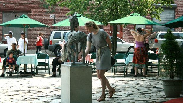 "Artist Ruth McKerrell shows her deer sculpture, ""Ancient"" to a friend."
