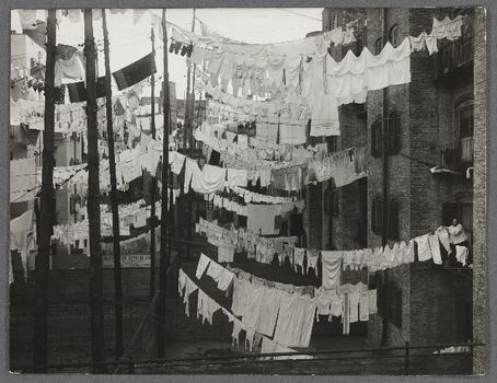 An exhibit at Columbia University looks at the early roots of documentary photography. Seen here: a 1910s image by Rockwoods Studio shows an air shaft full of hanging laundry.