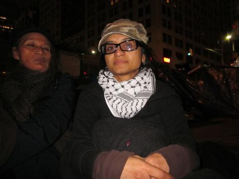 Saman Waquad, 28, volunteers in the Occupy Wall Street kitchen. She says it's going to take a long time for protesters' demands to be answered.
