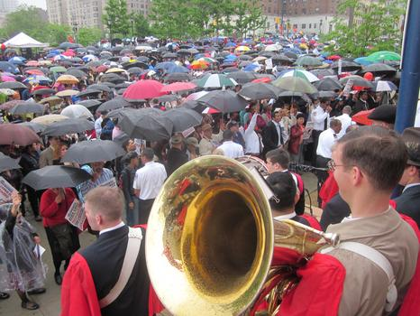 Rain didn't deter opponents, which numbered in the thousands