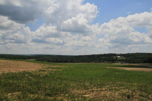 A view of the site from the Western Overlook, where the media was stationed in the days following the crash. The crash site is to the right and the new visitor's center and a farm are in the distance.