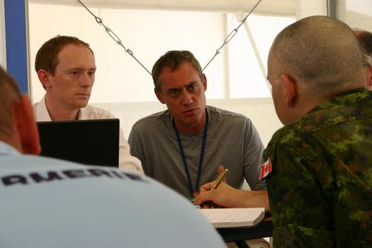 Shayne Gilbert, center, and a Canadian officer at the J.O.T.C.