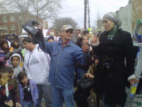 Activist and educator Debbie Almontaser speaks to supporters of the mosque