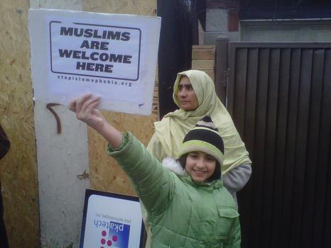 A young girl joined other supporters of a proposed mosque