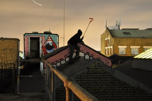 British artist Sweet Toof, known for toothy figures, is getting a solo show at Factory Fresh in Brooklyn. He is shown here redecorating a rooftop.