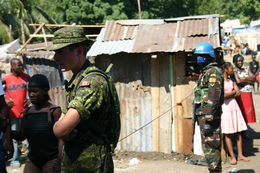 UN and Canadian troops working at an aid distribution site
