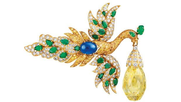 This 1971 brooch, which features yellow gold, sapphires, and yellow and white diamonds, was owned by Ganna Walska.