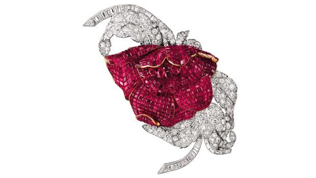Van Cleef & Arpels designed this peony brooch, fashioned from gold, platinum, diamonds and Mystery Set rubies, in 1937.