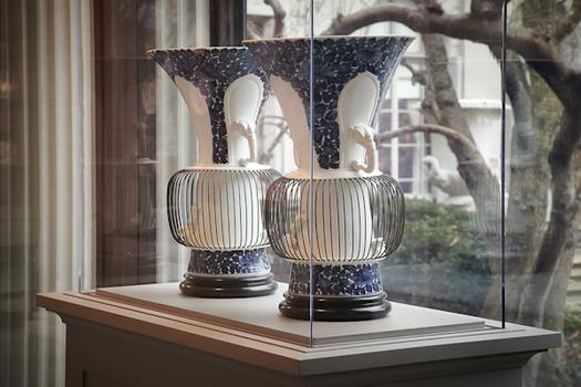 "The portico's first exhibit features dozens of Meissen porcelain pieces from the The Arnhold Collection. This is a pair of ""birdcage"" vases."