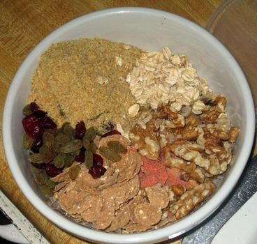 Breakfast: rolled organic oats; wholegrain organic flakes; dried cranberries and raisins; ground organic flax seeds; Gary Null's Red Stuff powder; rice milk