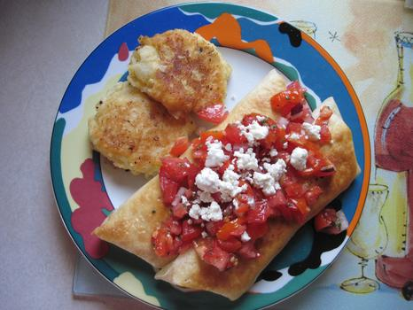 Dinner: chicken flautas filled with chicken, onion, garlic and feta cheese and topped with tomato salsa and feta; fried potato pancakes