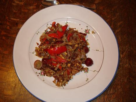 Dinner: red quinoa, sweet red pepper, onions, fresh and powdered garlic, seedless red grapes, fresh tarragon, toasted almonds, candy stripe fresh plum, salt and pepper