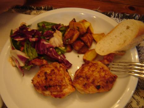 Dinner: barbecued chicken thighs, sautéed potatoes, arugula; radicchio and tomato salad