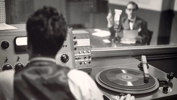 In 1936, Hogan partnered with Elliot Sanger and turned W2XR into WQXR, the first licensed high fidelity station in the U.S. and a commercial venture. Above: an early production booth at 730 Fifth Ave.