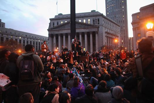 Protesters regroup in Foley Square after police in riot gear removed them from Zuccotti Park early on November 15.