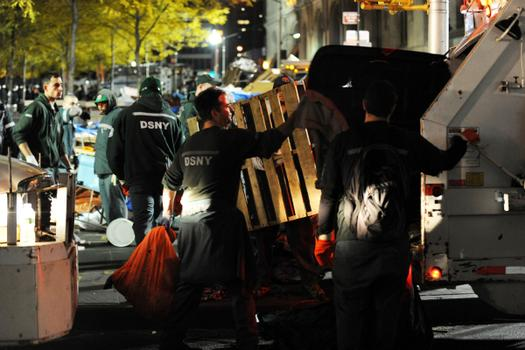 New York City sanitation workers clear the 'Occupy Wall Street' protest from Zuccotti Park in the early morning hours of November 15.