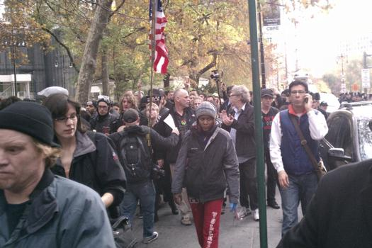 Protesters march through Lower Manhattan after they were cleared from Zuccotti Park early Tuesday.