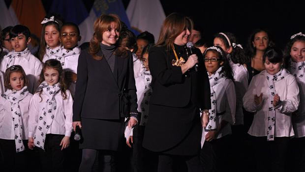 Luanne Sorrentino (center left) and Doreen Cugno, co-owners of the St. George's Theatre warm up the stage, with help from kids from the P.S. 29 Choir.