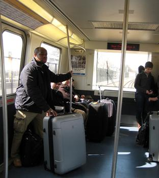 Passengers ride the AirTrain.