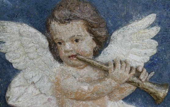 The original paint on the details, like this angel, has been restored meticulously.