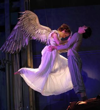 "Sofia Jean Gomez as 'The Angel' and Michael Urie as 'Prior Walter' in Signature Theatre Company's production of Kushner's ""Angels in America."""