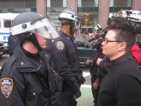 Rev. Ann Kantsfield faces off with NYPD at the Canal Street site.