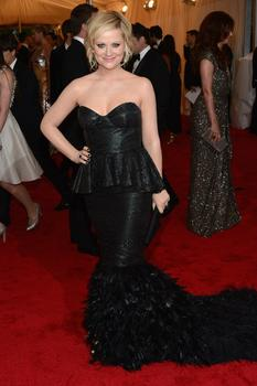 """Actress and comedian Amy Poehler wore a black-feathery dress made by the New York designer Fotini, while her husband Will Arnett wore, """"what is known as a tuxedo."""""""