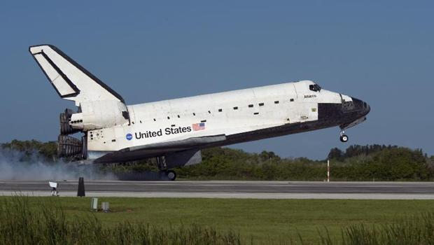 Space shuttle Atlantis' main gear touches down on Runway 33 at the Shuttle Landing Facility at NASA's Kennedy Space Center in Florida.