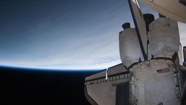 Earth's horizon and the blackness of space provide the backdrop for Atlantis' aft section while it was docked with the International Space Station during the STS-132 mission.