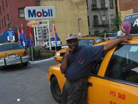 A cab driver stopped for gas just when the power went off.
