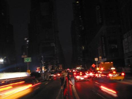 Times Square: dark except for vehicle tail lights