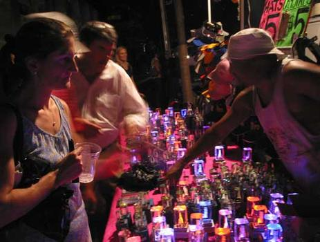 A Times Square souvenir vendor conducts business under the light from a portable generator.