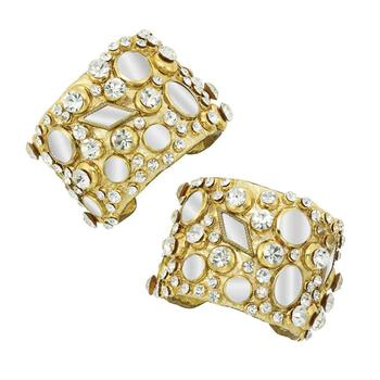 Jenny Lumet will wear this pair of 1970s gold metallic leather-studded cuffs studded with with large mirrored discs and rhinestones to the Academy Awards. The pair sold for $6,250.