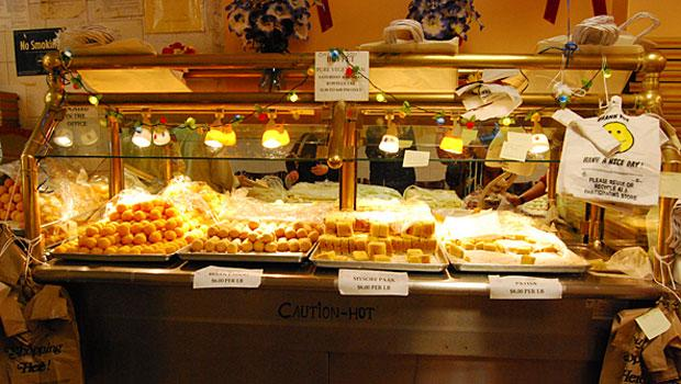 The buffet at Maharaja Sweets has been turned into a holding area for besan ladoo, mysore paak and patisa.