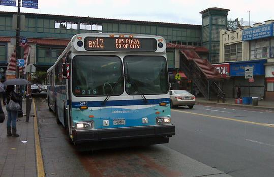 Bronx Select bus pulls into Fordham Road.